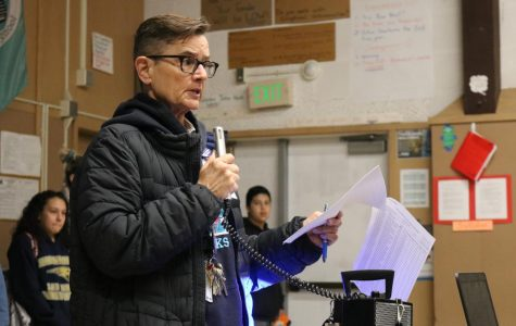 Principal Deb Smith addresses students in the MPR.